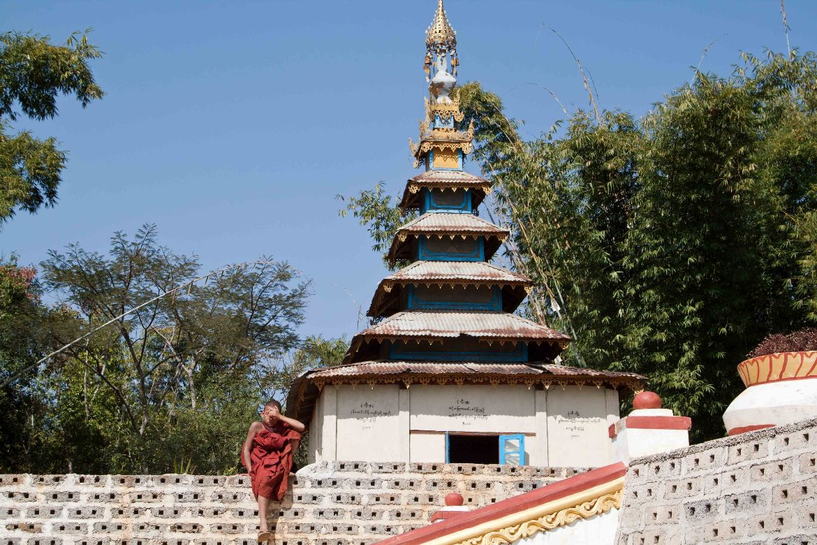 monk next to pagoda